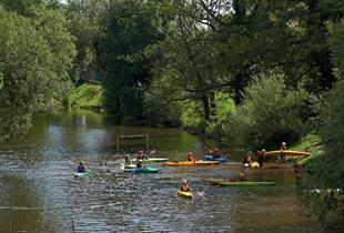 The lowlands of the Bruche river with a canoe-kayak